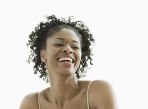 Gaithersburg, MD, USA --- Smiling African American woman --- Image by © Jon Feingersh/Blend Images/Corbis